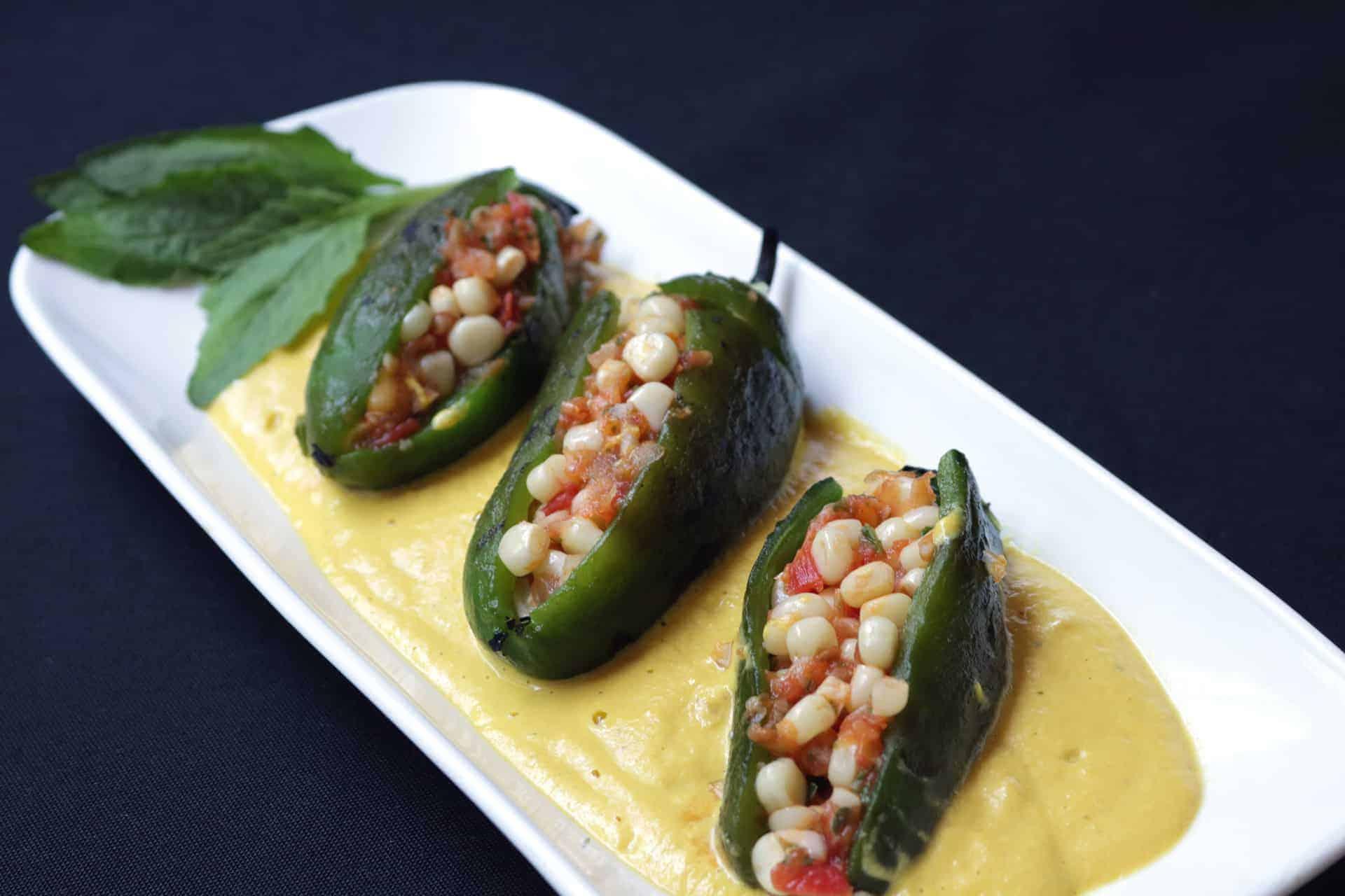 Chiles Cuaresmeños Rellenos De Elote En Salsa De Flor De Calabaza